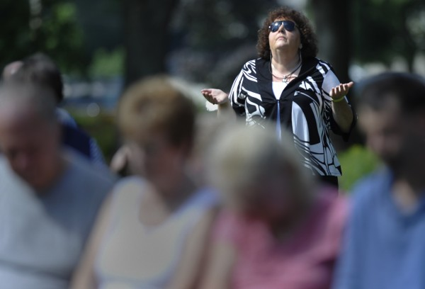 "Deborah Deane of Brewer, a self-described ""prayer warrior,""  joined other area worshippers to pray for the nation at Cascade Park in Bangor on Saturday morning, Aug. 6, 2011."