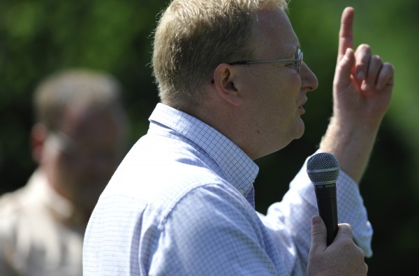 Pastor Phil Mumford of First Assembly of God in Bangor speaks to fellow worshippers as they gather to pray for the nation at Cascade Park in Bangor on Saturday morning, Aug. 6, 2011.