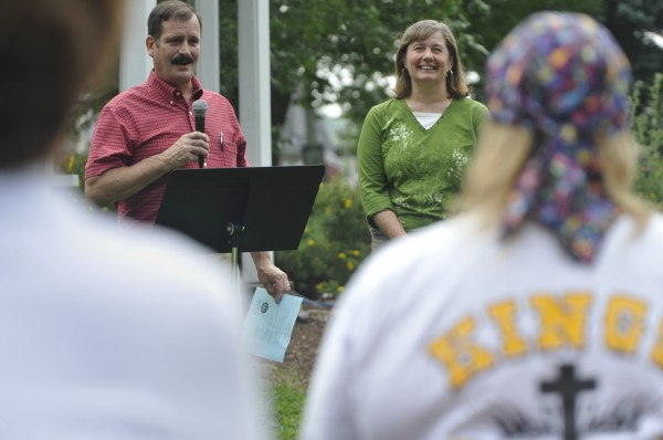 State Representatives Dave Johnson and Stacey Guerin speak to fellow worshippers after Johnson read Gov.Paul LePage's proclamation to join in prayer for the nation during their area worship event at Cascade Park in Bangor on Saturday morning, Aug. 6, 2011.