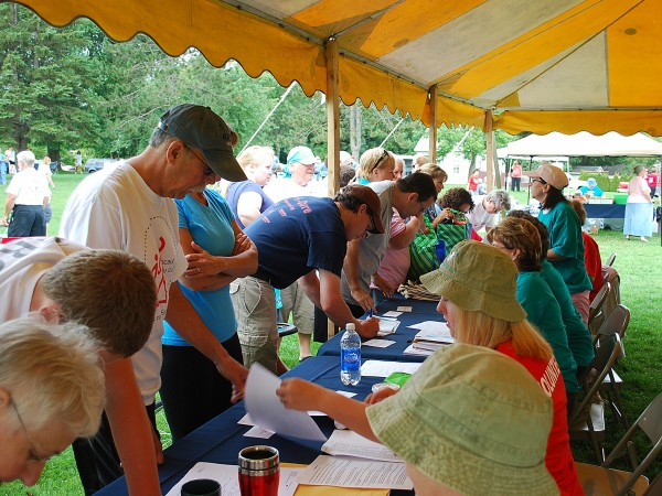Volunteers register Saturday, Aug. 27, for the fourth annual Bangor Walk to Defeat ALS, which drew more than 300 walkers for the 1.3- and 2.3-mile benefit walks.