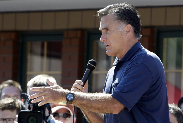 Republican presidential candidate former Massachusetts Gov. Mitt Romney reacts to a heckler during a campaign stop at the Iowa State Fair, Thursday, Aug. 11, 2011, in Des Moines, Iowa.