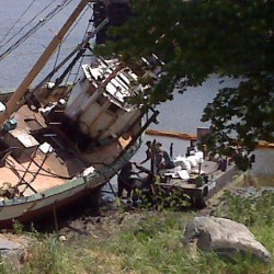 Boat still mired on mud flat in Hampden