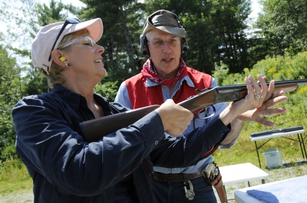 Debbie Harman of Penobscot gets a few pointers on proper shotgun handling from Albert Faust during Saturday's open house event at the Hampden Rifle and Pistol Club, of which Faust is a member. The Penobscot County Conservation Association sponsored the introductory shooting sports event at the club with the help of a National Rifle Association Foundation grant.