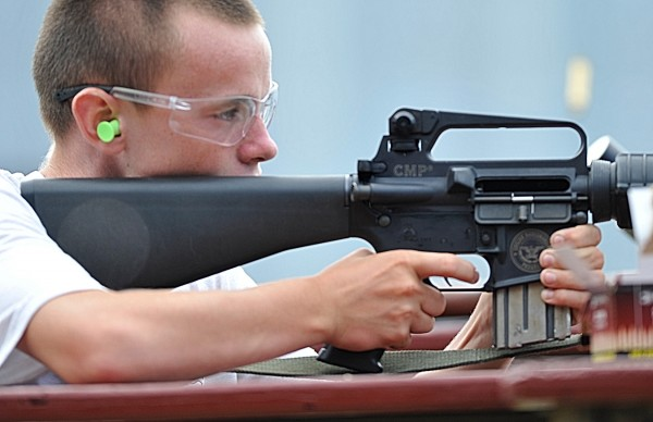 Austin Nute, 14, of Winterport pulls the trigger on an AR-15, a magazine-fed semi-automatic rifle, to hit a target 200 yards away during Saturday's open house event at the Hampden Rifle and Pistol Club.