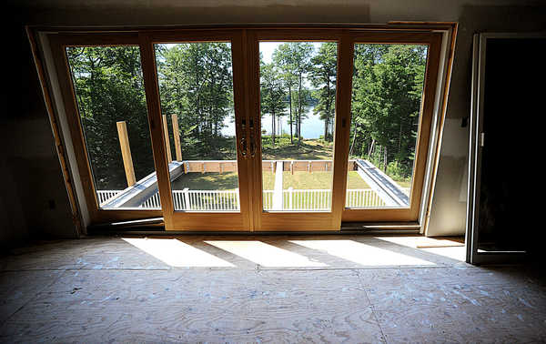 Long Lake is visible from the unfinished master bedroom at the former home of Dawn and Harvey Solomon on Zakelo Road in Harrison. The three-level home and garage, all unfinished, are set for auction Aug. 30.