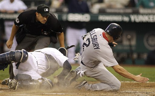 Seattle Mariners catcher Josh Bard, left, tags out Boston Red Sox's Jacoby Ellsbury at home as umpire Mark Ripperger watches the play in the fourth inning of a baseball game, Saturday night, Aug. 13, 2011, in Seattle. An argument over the call at the plate led to the ejection of Red Sox manager Terry Francona.