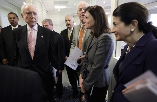 Sen. Orrin Hatch, R-Utah (second from left) talks with Republican colleagues, on Capitol Hill in Washington on Wednesday, Jan. 26, 2011, before discuss the introduction of legislation for a balanced budget amendment. From left are, Hatch; Sen. James Inhofe, R-Okla.; Sen. John Ensign, R-Nev.; Sen. .John Cornyn, R-Texas; Sen. Kelly Ayotte, R-N.H.; and Sen. Olympia Snowe, R-Maine.