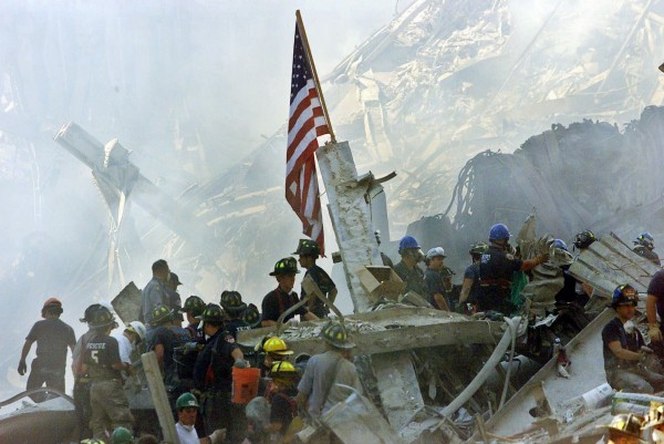 An American flag flies over the rubble of the collapsed World Trade Center buidlings in New York on Sept. 13, 2001.