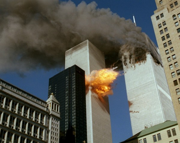 United Airlines Flight 175 collides into the south tower of the World Trade Center in New York as smoke billows from the north tower on Sept. 11, 2001.