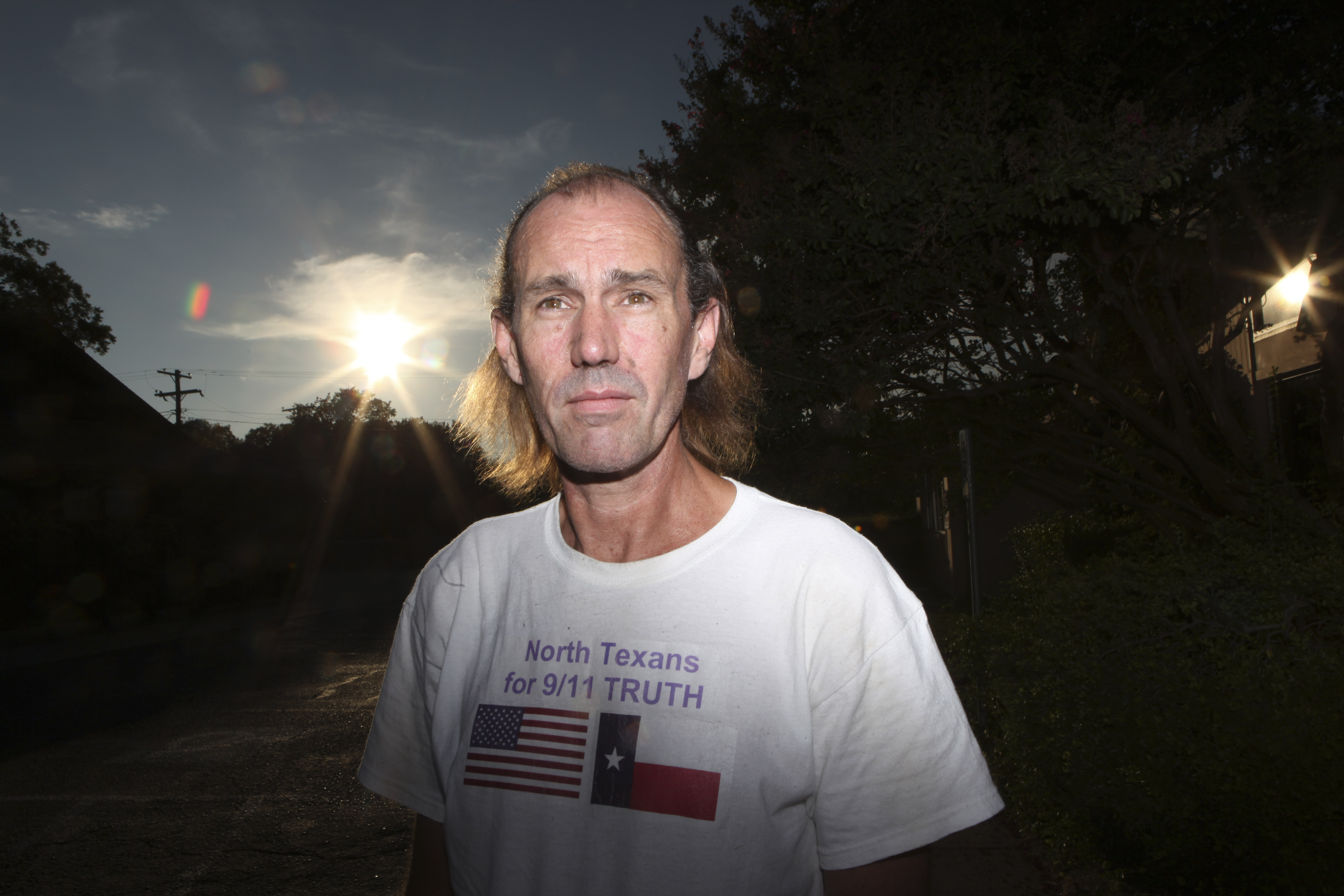 "In this July 19, 2011 photo, Bryan Black, with the North Texans for 9/11 Truth group, poses for a photo in Dallas. Nationwide, the skeptics, who prefer the term ""9/11 truth activists"" instead of the moniker ""truthers,"" generally have about a dozen beliefs surrounding what happened on that day, although there are some variations on who was responsible for the attacks and why. Among the beliefs: that the World Trade Center buildings could never have collapsed due to fire, that the buildings were brought down by explosives, that there were warnings of the impending attacks from 11 different countries and that fighter jets could have intercepted at least one of the four planes that day. Many believe that there were criminal elements within the government that caused the attacks."