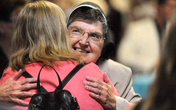 Sister Mary Norberta, president and CEO of St. Joseph Hospital, gets a hug during a reception held in her honor at the Bangor Civic Center on Wednesday evening.