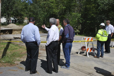 Gov. Paul LePage and Town Manager Carlo Puiia review Swain Road damage.