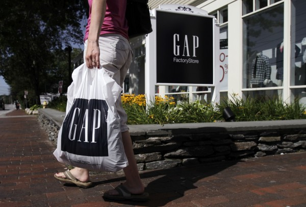 This Aug. 17, 2011 file photo shows a shopper leaving a Gap store in Freeport, Maine.