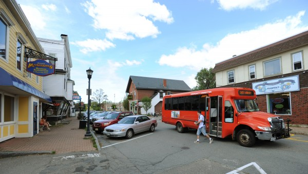 The Bat bus drops off riders along Mill Street in Orono on Wednesday, August 31, 2011. UMaine students can recieve a Shuttle Passport and have it stamped when they visit Orono merchants. After 20 visits they can use it to be entered into a drawing to win a bicycle.