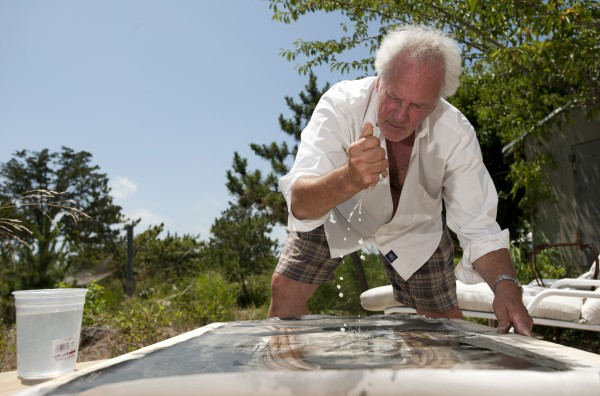 Artist Donald Lipski works on one of his latest pieces; Gathering Dust: Pine Needles No. 1, at his Amagansett, New York studio, July 26, 2011.