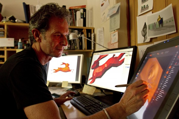 """At his home in Denver, Colorado, on Monday, July 25, 2011, artist Lawrence Argent demonstrates some of the three-dimensional computer software which he uses to design some of his sculptures, including the 56-foot-long rabbit (on two left monitors) which is being installed in the Sacramento, California, airport. Argent is also known for creating """"I see what you mean,"""" a two-story tall, digitally modeled, blue bear sculpture which peers into the Colorado Convention Center in Denver."""