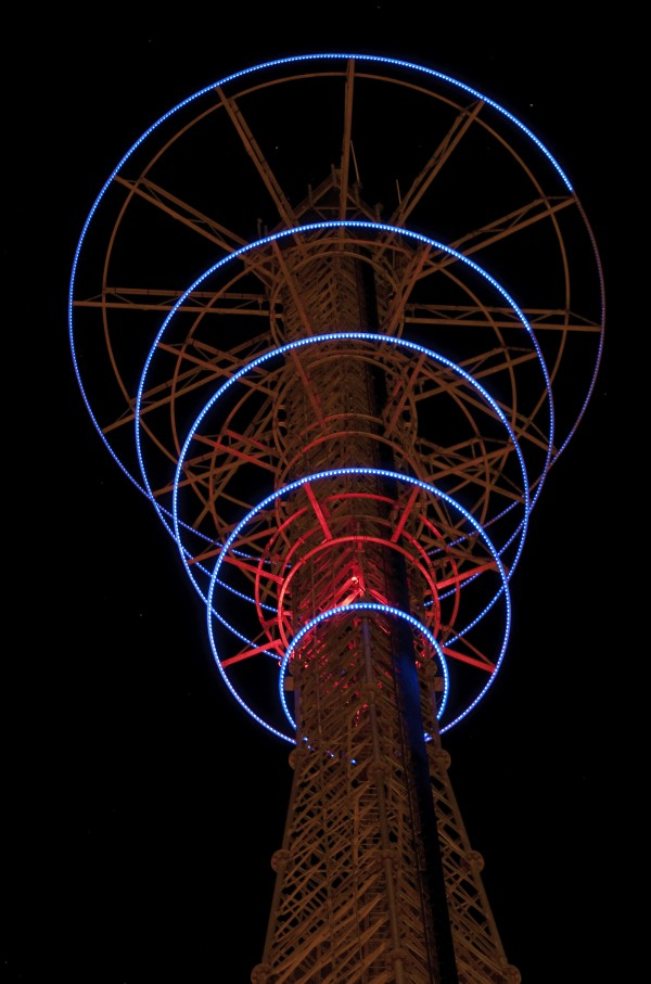 """""""Night Song"""" a radio tower inspired by the RKO Radio trademark of movie fame from the 1930s is a 460 ft. city-owned communications tower in Fort Worth, Texas, that has five graduated rings of LED lights ? from 12 ft. to 15 ft. in diameter designed by Connie Arismendi and Laura Garanzuay -- which will change with the seasons. And the price tag, a modest $68,695, underscores that public art can surprise and please a great number of people without necessarily costing a great deal of money."""