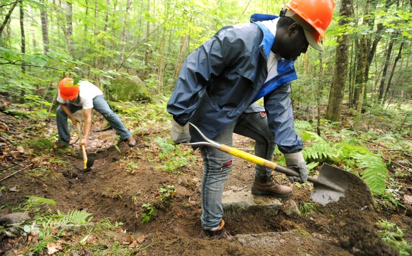 Daniel Jamison, 17, of New York, NY (right) and Alejandro Meran, 16, of New Haven, CT work on clearing a water drain along the hiking trail in the Debsconeag Lakes Wilderness Area northwest of Millinocket on Wednesday, August 3, 2011.  They were among the interns with the Nature Concervancy's Leaders in Environmental Action for the Future program and spent four weeks in Maine working on trails in s outhern and northen parts of the state.