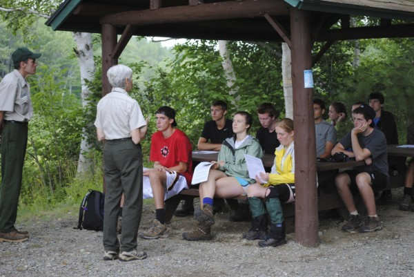 The students in the Maine Youth Wilderness Leadership Program listen to Gabe and Marcia Williamson explain Leave No Trace practices prior to the students' 8-day backpacking trip through Baxter State Park.