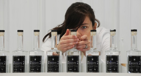 Jessica Jewell labels bottles of Twenty 2 Vodka at the distillery she owns with her husband, Scott Galbiati, in Houlton in January 2010. The idea to manufacture vodka started as a college project and quickly turned into a family business.