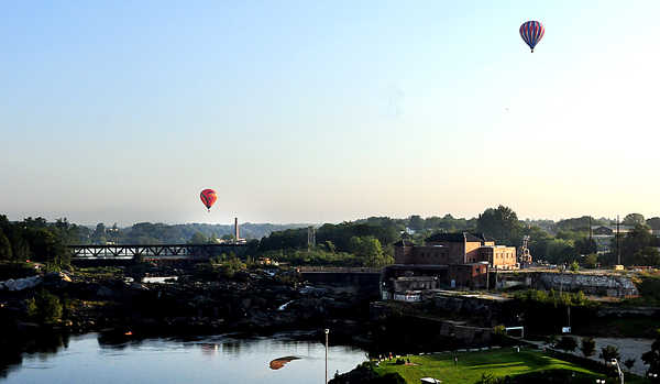 Balloons float over the Androscoggin River on Friday morning after a perfect first launch of the 19th Annual Great Falls Balloon Festival.