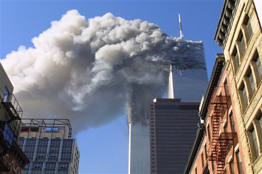 The twin towers of the World Trade Center burn after hijacked planes crashed into them in New York on Sept. 11, 2001. As the post-Sept. 11 decade ends, some foreign families of the victims are eager to move past the tragedy. But though the pain transcended borders, foreign families have battled to cope with their loss from afar.