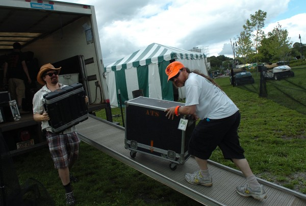 Laird Nolan (left) of Cambridge, Mass. and Max Azanow (right) of Boston unload musical equipment at the Penobscot Stage on Friday morning in preparation of the opening night of the 2011 American Folk Festival on the Bangor Waterfront.  Azanow has been coming to Bangor every August to work at the festival since it began ten years ago.