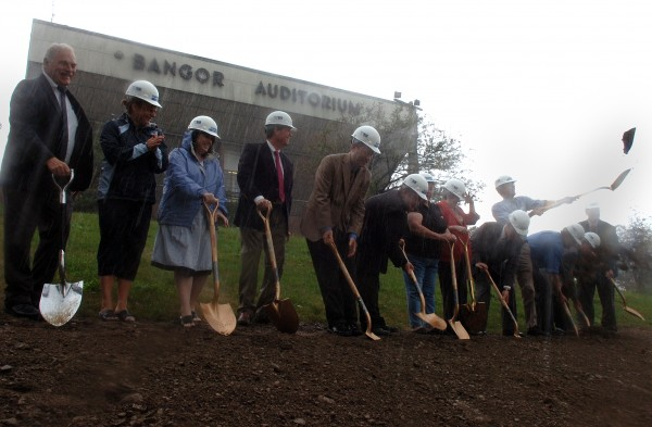 In the middle of a downpour, officials partake in a groundbreaking for the new arena at Bass Park in Bangor on Thursday, August 4, 2011. The arena is scheduled for completion in 2013.