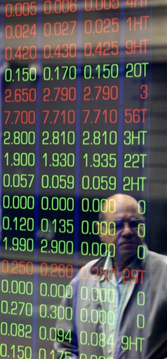 A man watches news on display boards at the Australian Stock market in Sydney, Australia, Thursday, Aug. 11, 2011. Asian markets headed sharply lower early Thursday over mounting concerns about the health of Europe's banks and France's debt rating.