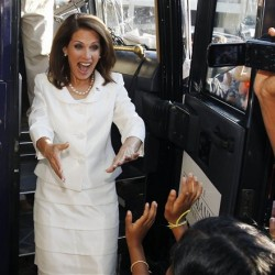 Republican presidential candidate Rep. Michele Bachmann, R-Minn., reacts to a group of supporters as emerges from her campaign bus after winning the Republican Party's Straw Poll in Ames, Iowa, Saturday.