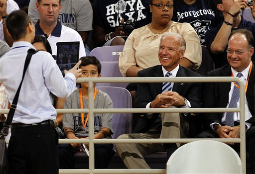 U.S. Vice President Joseph Biden, second from right, smiles as a Chinese man uses a tablet computer to take a picture of him at a U.S.-China friendship basketball match held at the Olympics sports center in Beijing, China, Wednesday, Aug. 17.