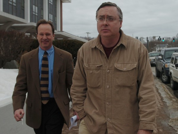 Attorney Peter Rodway (from left) and his client, James M. Cameron, leave the Margaret Chase Smith Federal Building in Bangor after Cameron made his first federal court appearance on Tuesday, February 17, 2009.