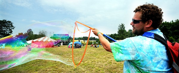 Mike Dumais, from Stafford, Conn., makes a huge bubble in-between sets at the Camp Creek Music Festival Saturday, Aug. 7, 2011.