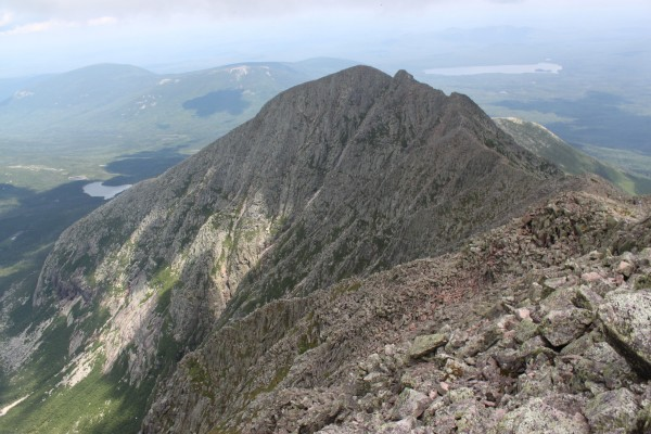 Knife Edge, the arete of Mount Katahdin that spans between Baxter Peak and Pamola Peak, is clear for passage on Sunday, Aug. 14, 2011. This view is taken from Baxter Peak looking toward Pamola Peak, the farthest hump. The Chimney of Knife Edge is the dip just before Pamola Peak.