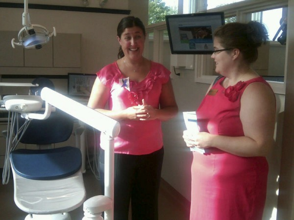 Denise Astle (left), a senior in the dental hygiene program at the University of Maine at Augusta''s Bangor campus, describes some of the state-of-the-art equipment in the campus's new dental health clinic while leading a tour during a dedication ceremony Wednesday. Deidre Grant (right), a member of U.S. Sen. Susan Collins' staff assigned to health and education issues, was among the dozens who showed up for the event.