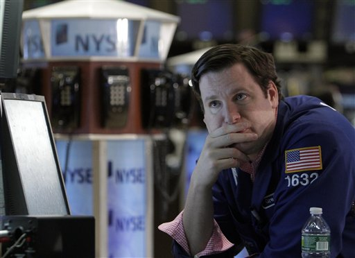 Specialist Gregg Maloney works at his post on the floor of the New York Stock Exchange Friday, Aug. 12, 2011. A wild week ended relatively calmly on Wall Street Friday as the Dow gained 126 points to 11,269 and the S&P was up 6 points.