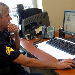 Sgt. Paul Edwards of the Bangor Police Department looks over law enforcement Facebook pages on Monday, August 22, 2011. Edwards said using Facebook has helped the department solve numerous crimes in recent months, including a bank robbery and many shoplifting cases.