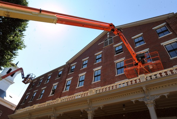 Workers put the finishing touches on the outside of the Maine Hall at the former campus of the Bangor Theological Seminary. The building soon will serve as senior housing.