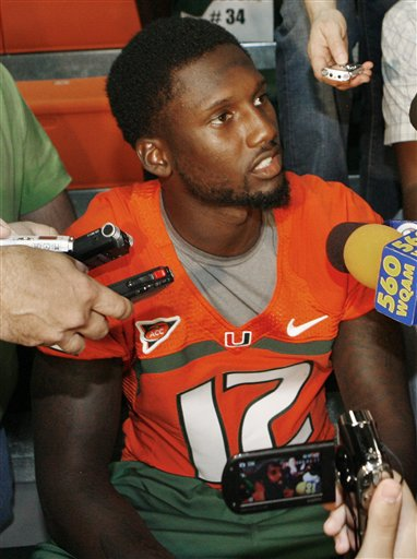 Miami quarterback Jacory Harris answers questions during  media day in Coral Gables, Fla., Saturday, Aug. 27, 2011. Harris will the team's opening game due to NCAA penalties over rules he broke while associating with a convicted Ponzi scheme architect.
