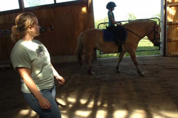 Respah Mitchell, left, of Hooves of Hope therapeutic riding program, watches student Mercedes Severance, 7, of Carmel, during a lesson on Monday, August 1, 2011. Mitchell, an avid rider and special education teacher, runs the programs out of her Hermon horse farm.