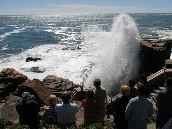 Tourists admire spray from waves crashing into Thunder Hole on Monday morning in Acadia National Park. Park officials said Monday that Irene caused minimal damage in the park, but as a precaution they still were keeping visitors back Monday morning from the rocks where the surf was hitting the shore.