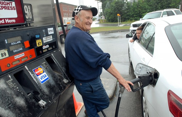 Joe Kalel pumps gas and gives directions to Patti Benoit of Boston, who was heading to Canada through Calais on Wednesday, August 10, 2011.