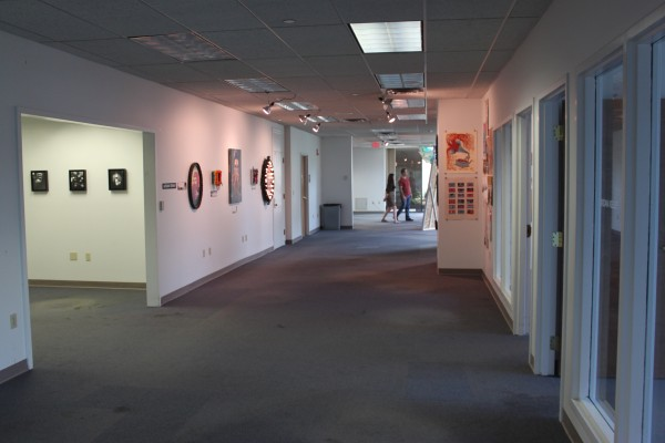 People visit the temporary Kaleidoscope Gallery on their opening day on Saturday, Aug. 6. The Nonprofit KahBang Arts and Maine artists have transformed the corporate building at 1 Merchant Plaza, which will be filled with artwork through Aug. 13.