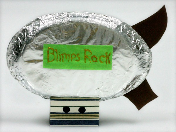 Paper plates wrapped with aluminum foil make a blimp craft project perfect for National Aviation Day.