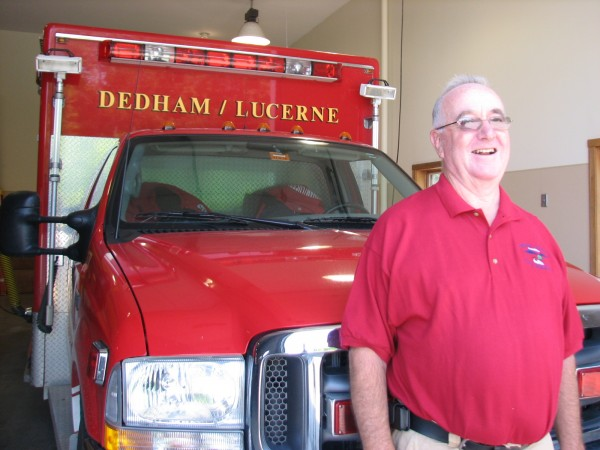 Francis &quotFrank&quot Myatt, the recently retired chief of the Dedham-Lucerne Fire Department, stands in front of a department vehicle on Saturday, Aug. 13, 2011. Myatt, who joined the department in 1975 and served as chief since 1983, officially retired on Aug. 5.