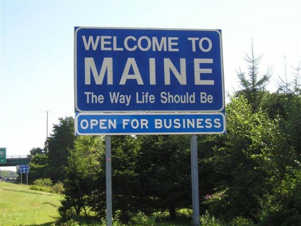 "A group of businessmen pitched in to buy a new ""Open for Business"" sign to fix underneath the ""welcome"" sign after a previous sign was stolen in late May."