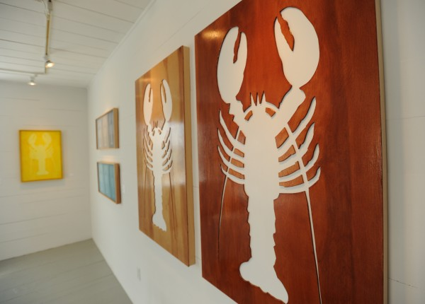 Wooden pieces featuring a lobster design created by Orlando Johnson are on display at the Hopkins Wharf Gallery on North haven on Thursday, July 21, 2011.