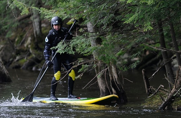 Rafael Grossmann, M.D. of Holden navigated his stand-up paddle board upstream through a calm water section of the Stillwater River, just below the Stillwater Dam in Old Town on May 11, 2011.
