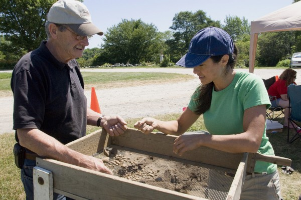 Dennis Jipson of Greene and his daughter Janie Jipson Bisson of North Yarmouth search for historic artifacts after sifting material taken from an achaeological dig on July 28, 2011 at the former Pemaquid Colony in South Bristol. Volunteers at the dig unearthed dozens of artifacts during the process.