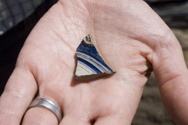 Betsy Poulin of Waterville displays a shard of Westerald salt-glazed pottery, one of the prize finds at an archaeological dig on July 28, 2011, at the site of the 17th Century Pemaquid colony. Despite being buried for far more than 300 years, the shard came out of the ground in brilliant blue and white.
